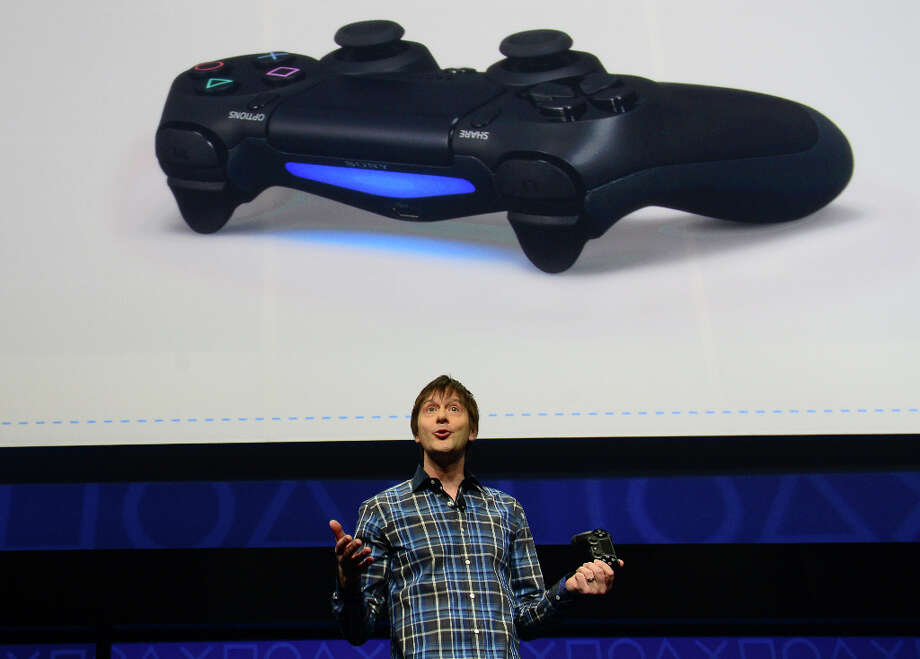 Video game designer Mark Cerny talks about the new controler Bioshock 4 as Sony introduces the PlayStation 4 at a news conference February 20, 2013 in New York.  AFP PHOTO/EMMANUEL DUNANDEMMANUEL DUNAND/AFP/Getty Images Photo: EMMANUEL DUNAND, AFP/Getty Images / AFP