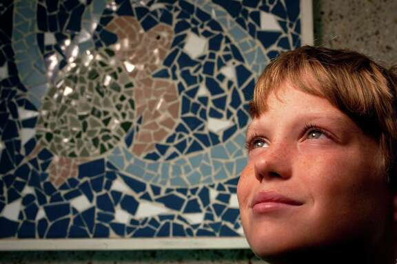 Axel Denner, 10, is a fourth grader on the Oppe Elementary School's Green Team, which is a group of 20 students who helped write a bill to make the Kemp's ridley sea turtle the state sea turtle Wednesday, Feb. 20, 2013, in Galveston.