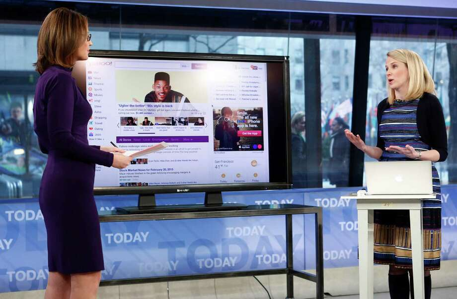 "This image released by NBC shows host Savannah Guthrie, left, with Yahoo CEO Marissa Mayer on NBC News' ""Today"" show, Wednesday, Feb. 20, 2013 in New York as Mayer introduces the website's redesign. Yahoo is renovating the main entry into its website in an effort to get people to visit more frequently and linger for longer periods of time. The long-awaited makeover of Yahoo.com's home page is the most notable change to the website since the Internet company hired Marissa Mayer as its CEO seven months ago. The new look will start to gradually roll out in the U.S early Wednesday. (AP Photo/NBC Peter Kramer/NBC/NBC NewsWire) Photo: Peter Kramer"