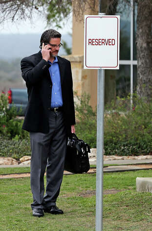 Scooter Store Senior VP Tim Zipp talks on his cell phone in the side yard of building No. 1 at the New Braunfels company location before getting in his automobile and exiting the scene as federal agents from the FBI conduct a search warrant inside on Feb. 20, 2013. Photo: TOM REEL