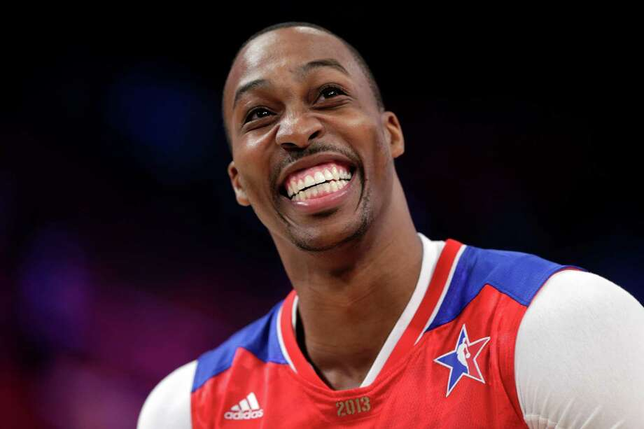 Lakers center Dwight Howard was all smiles at Sunday's All-Star Game before Gregg Popovich reportedly put him in his place during a timeout. Photo: Eric Gay, Associated Press / AP