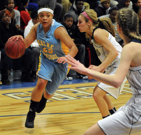 Kolbe Cathedral's Nakayla Nelson drives the ball past Lauralton Hall defenders during SWC girls high school basketball semi-final action at Notre Dame High School, in Fairfield, Conn., Feb. 20th, 2013. Photo: Ned Gerard / Connecticut Post