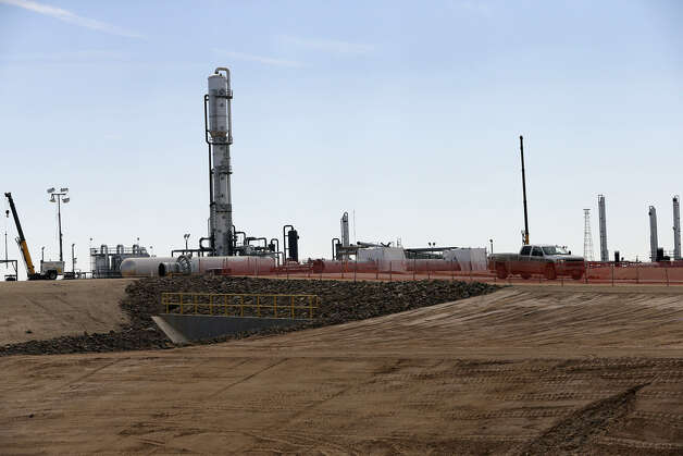 Anadarko builds a gas processing plant south of Cotulla. A company official says Anadarko's success in the Eagle Ford Shale and others has prepared it for shale work internationally. Photo: Tom Reel / San Antonio Express-News