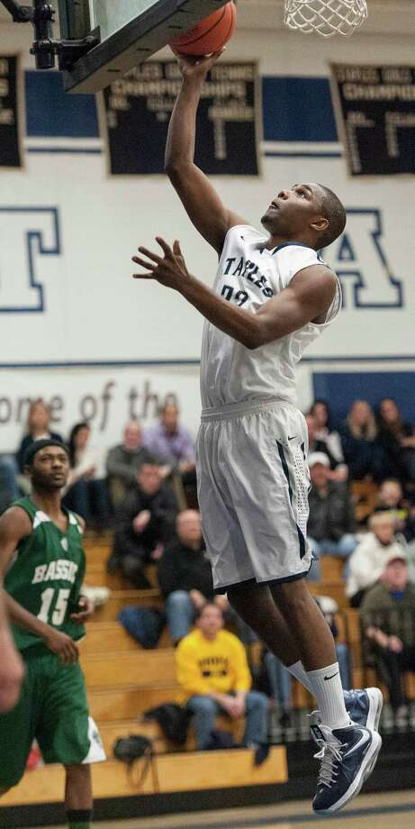 Staples high school's Darryle Wiggins goes up for a basket in a boys basketball game against Bassick high school played at Staples high school, Westport, CT Wednesday February 20th, 2013. Photo: Mark Conrad / Connecticut Post Freelance