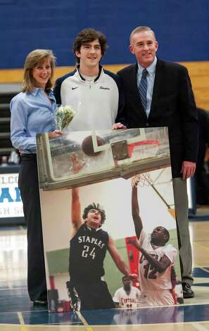 Staples's Ross Whelan takes part in the senior night ceremony before the Staples high school boys basketball game against Bassick high school played at Staples high school, Westport, CT Wednesday February 20th, 2013. Photo: Mark Conrad / Connecticut Post Freelance