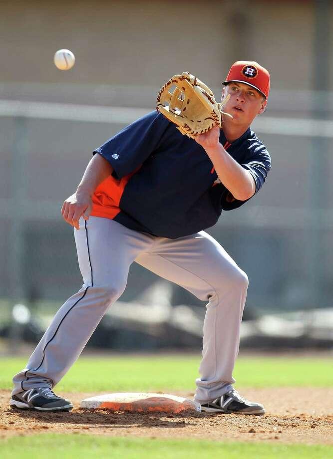 Smooth-fielding, soft-spoken Matt Dominguez is in line to be the Astros' regular third baseman this season. Photo: Karen Warren, Staff / © 2013 Houston Chronicle