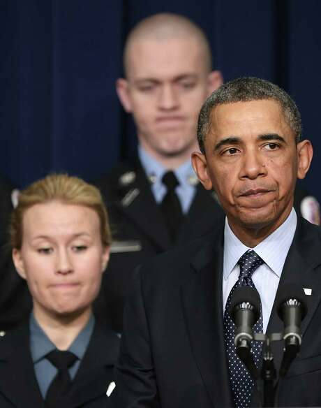 Surrounded by first responders who might be affected by looming budget cuts, President Barack Obama addresses the urgency of avoiding the sequester. Photo: Win McNamee / Getty Images