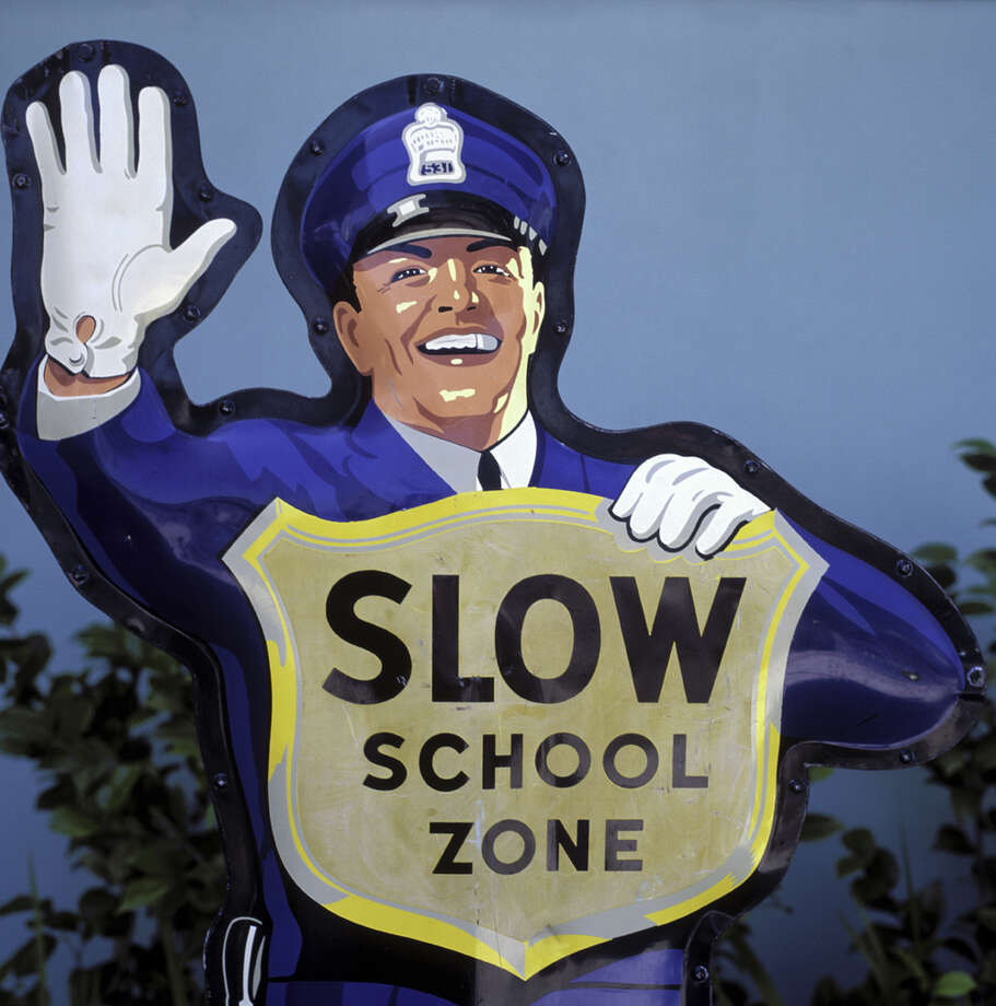 """There are many elements to it,"" Seattle Department of Transportation spokesman Rick Sheridan said when previously asked. ""But basically, the school zone signs are in effect when children are near the roadway during times in which they are going to and from school."" If a school does not hold summer classes, the school speed limit does not apply, he said. ""If one child were around the roadway at say 10 in the morning, that's not the normal time for children in the school zone area, so that wouldn't necessarily qualify the school speed limit,"" Sheridan said. Seattle Police spokesman Mark Jamieson referenced Seattle Municipal Code 11.52.100, which states the speed zone at the crosswalk shall extend 300 feet in either direction from the marked crosswalk, and the school or playground zone may extend 300 feet from the border of the school or playground. But those restrictions may include only the area consistent with active school or playground use. Photo: Purestock/Getty Images"