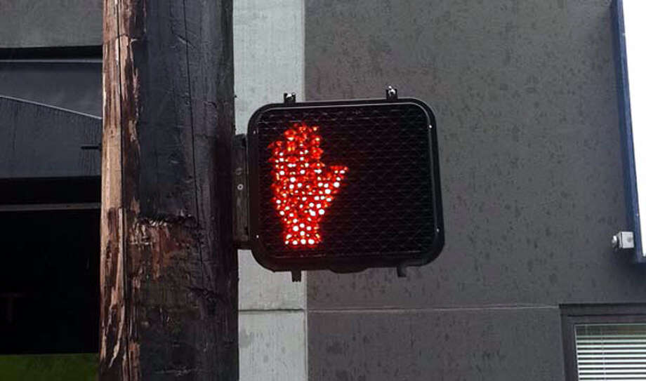 Can I legally cross when the orange hand is flashing?