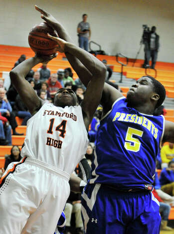 Harding's Jaymar Gaynor fouls Stamford's Ken Wright during their game at Stamford High School on Wednesday, Feb. 20, 2013. Harding won, 63-62. Photo: Jason Rearick / The Advocate