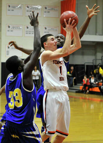 Stamford's Joe Palumbo shoots while under pressure from Harding's Dennis Hinds, left, and Davaun McAlister, from behind, during their game at Stamford High School on Wednesday, Feb. 20, 2013. Harding won, 63-62. Photo: Jason Rearick / The Advocate