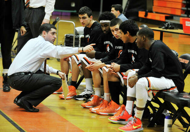 Stamford head coach Danny Melzer gives directions to his starters before their game against Harding at Stamford High School on Wednesday, Feb. 20, 2013. Harding won, 63-62. Photo: Jason Rearick / The Advocate