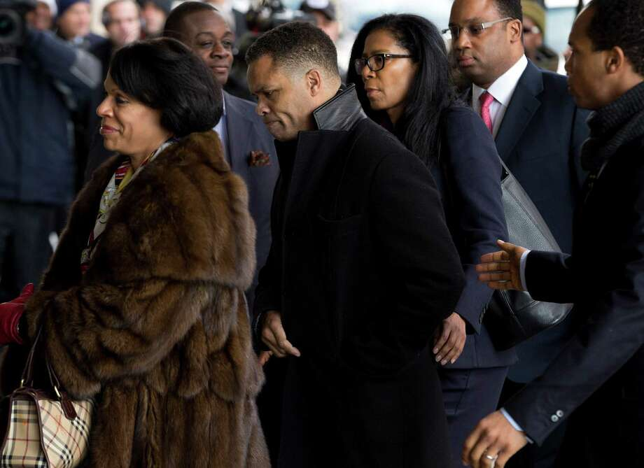 Former Illinois Rep. Jesse Jackson Jr., center, arrives at the E. Barrett Prettyman Federal Courthouse in Washington, Wednesday, Feb. 20, 2013. Jackson and his wife were to appear in federal court to answer criminal charges that they engaged in an alleged scheme to spend $750,000 in campaign funds on personal items. (AP Photo/Evan Vucci) Photo: Evan Vucci