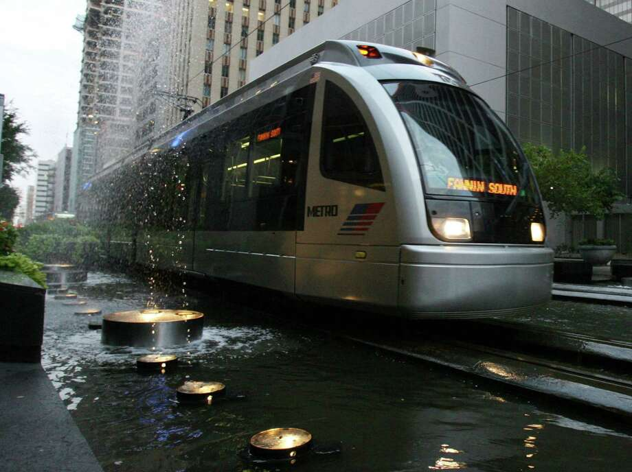 Metro officials say daypasses could save costs and encourage more use of its light-rail and bus services. While retro­fitting the fare system could cost as much as $1.7 million, according to one analysis, officials say the actual cost should be lower. Photo: Billy Smith II, Staff / Houston Chronicle