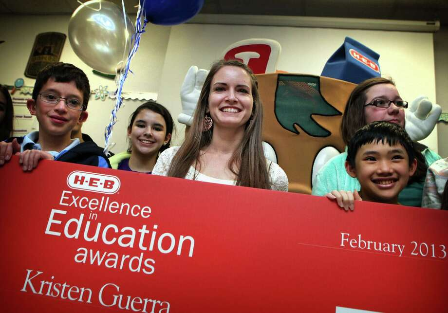 Students surround Tejeda Middle School teacher Kristen Guerra (center), who is one of eight local finalists for award. Photo: Bob Owen, San Antonio Express-News