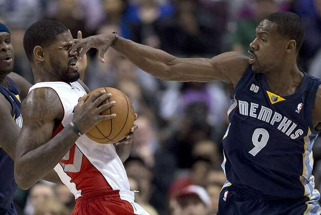 The Moe Howard defense: Tony Allen pokes Amir Johnson during the Raptors-Grizzlies game in Toronto. Photo: Frank Gunn, Associated Press