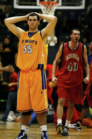 St. Mary's forward Kevin Kotzur reacts after the final second ticked off the clock in the Rattlers' overtime loss at Greehey Arena on Feb. 20, 2010, to Incarnate Word. Incarnate Word won 78-75. Incarnate Word's Tamas Cseh celebrates at right. Photo: Michael Miller, San Antonio Express-News / mmiller@express-news.net