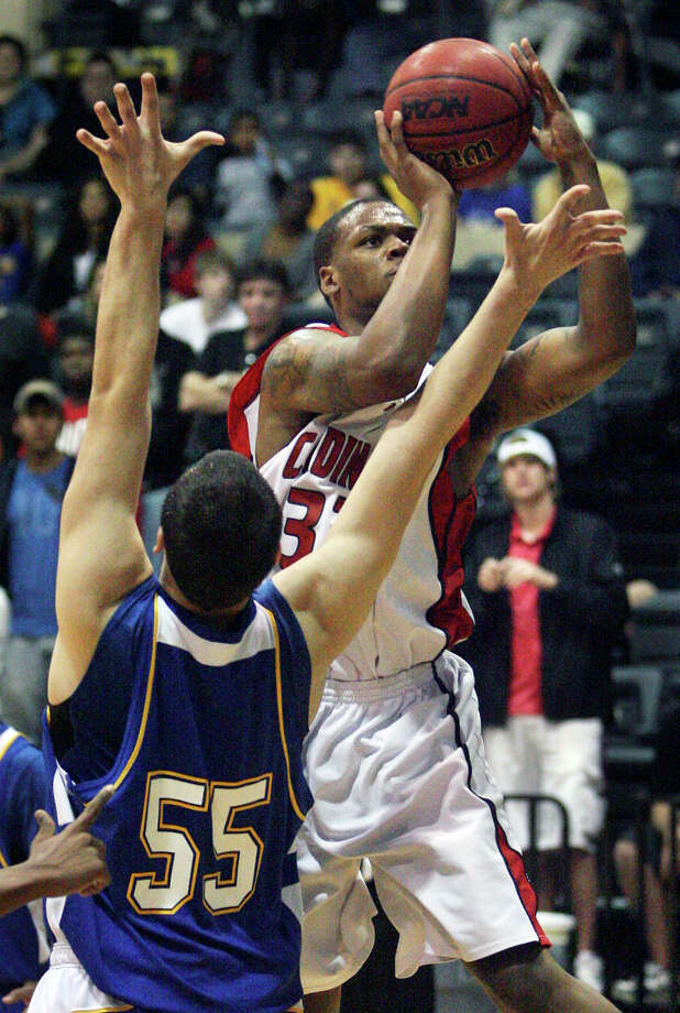Tracy Robinson gets a shot off for UIW around St. Mary's Kevin Kotzur during the Heartland Conference Championship game at Greehey Arena on March 6, 2010. Photo: Tom Reel, San Antonio Express-News / © 2010 San Antonio Express-News