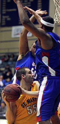 Rattlers forward Kevin Kotzur is surrounded by Oklahoma Panhandle State University defenders during their game at Greehey Arena on Jan. 13, 2011. Photo: Tom Reel, San Antonio Express-News / © 2010 San Antonio Express-News
