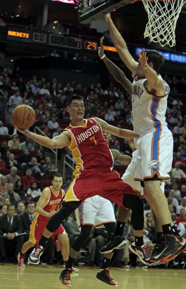 Feb. 20: Rockets 122, Thunder 119Jeremy Lin of the Rockets makes a pass as Thunder defenders try to interfere.