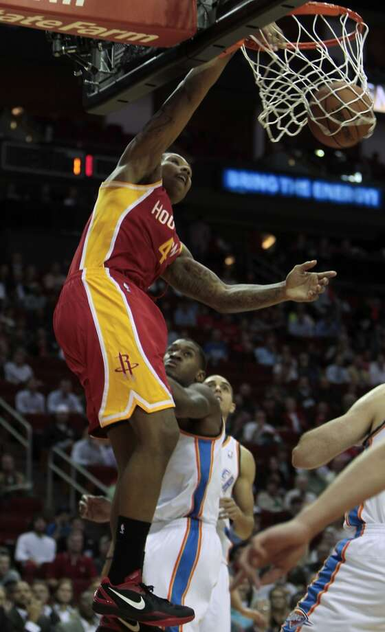 Rockets center Greg Smith gets an easy two points on a dunk.