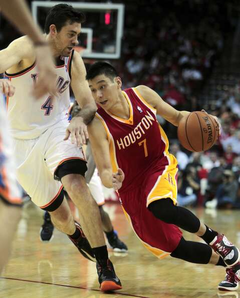 Rockets point guard Jeremy Lin drives the ball against Nick Collison of the Thunder.