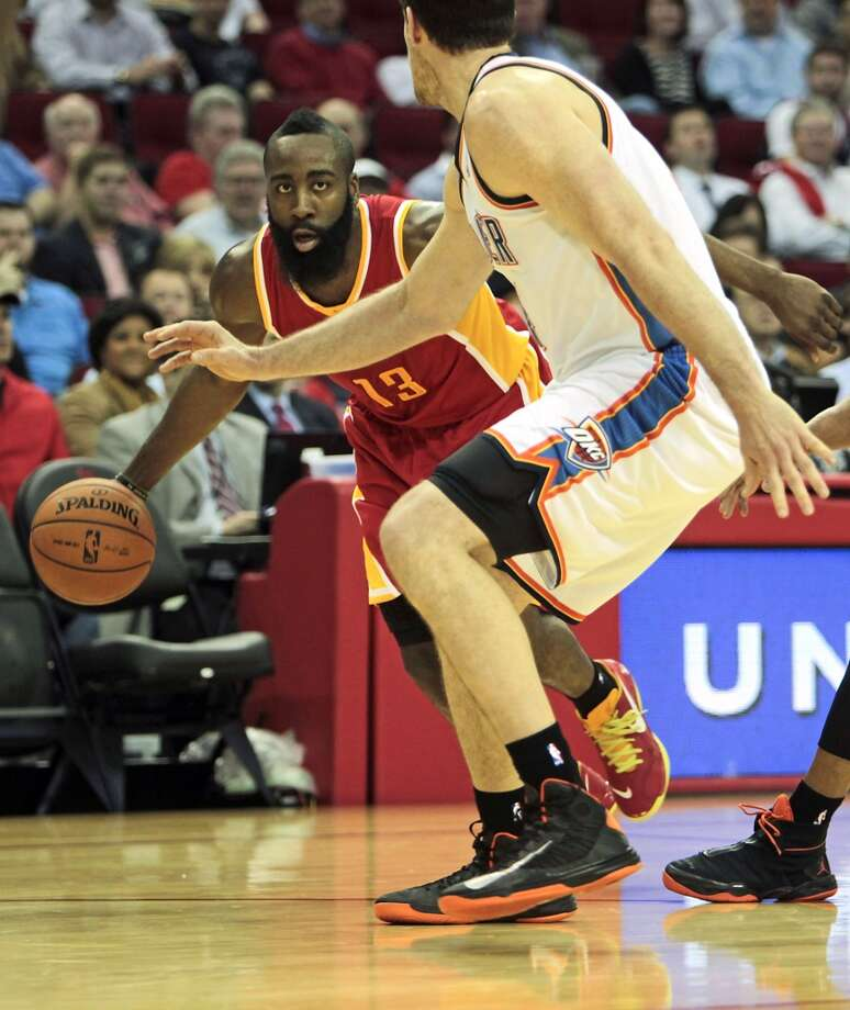 James Harden of the Rockets looks to penetrate the Thunder defense.