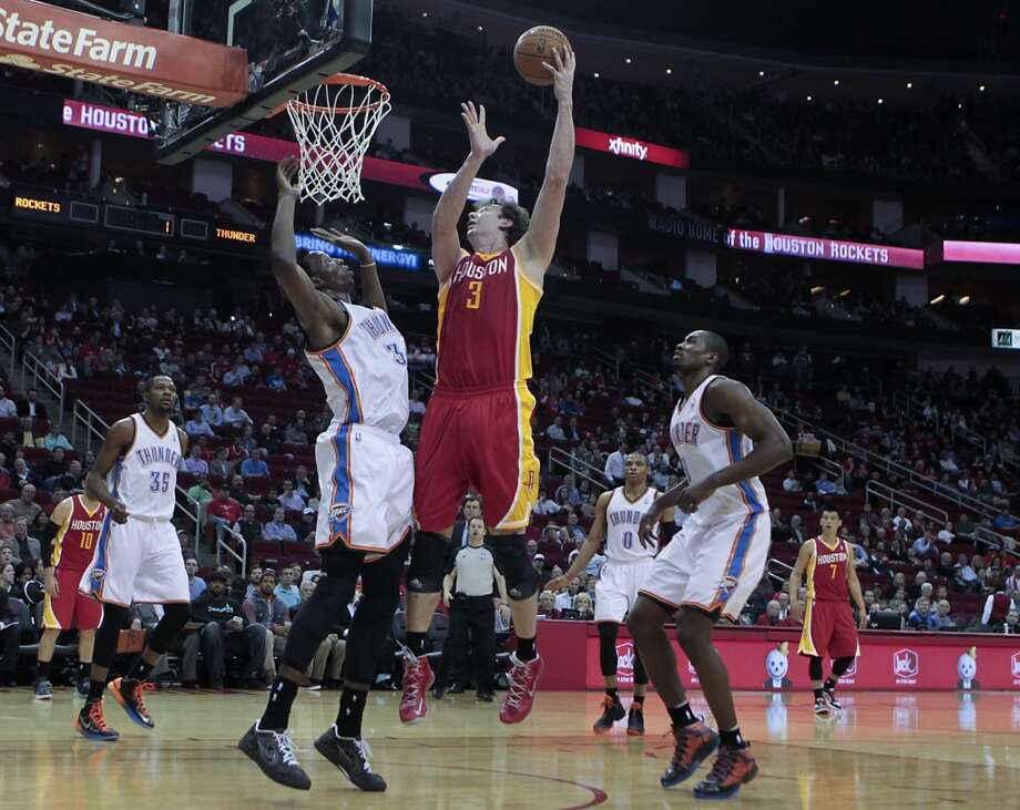 Rockets center Omer Asik attempts a shot.