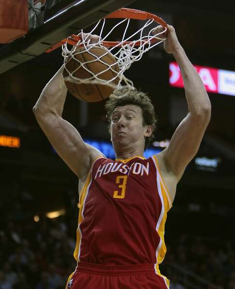 Rockets center Omer Asik puts down a slam.