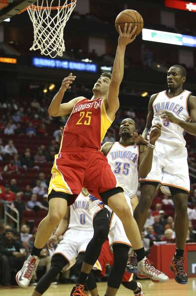 Rockets forward Chandler Parsons drives to the basket against Oklahoma City.