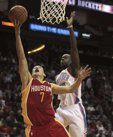 Rockets point guard Jeremy Lin drives past the Thunder defense.