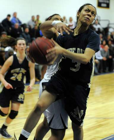 Notre Dame's Amber James drives to the net against Pomperaug during SWC girls high school basketball semi-final action at Notre Dame High School, in Fairfield, Conn., Feb. 20th, 2013. Photo: Ned Gerard / Connecticut Post