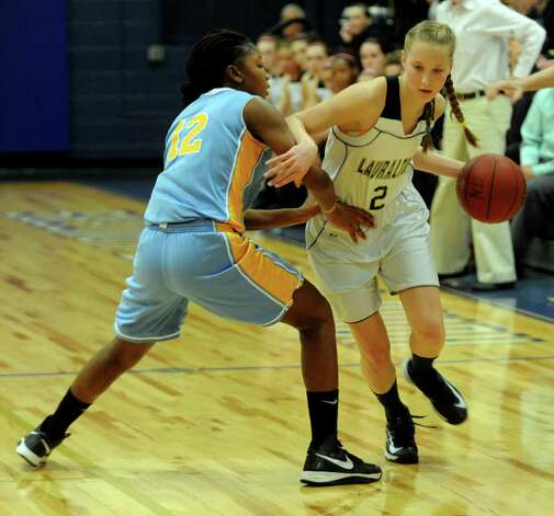 Lauralton Hall's Emma McCarthy controls the ball against Kolbe Cathedral defender Denisha Gardner during SWC girls high school basketball semi-final action at Notre Dame High School, in Fairfield, Conn., Feb. 20th, 2013. Photo: Ned Gerard / Connecticut Post