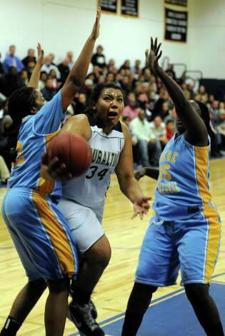 Lauralton Hall's Olivia Levey drives between two Kolbe Cathedral defenders during SWC girls high school basketball semi-final action at Notre Dame High School, in Fairfield, Conn., Feb. 20th, 2013. Photo: Ned Gerard / Connecticut Post
