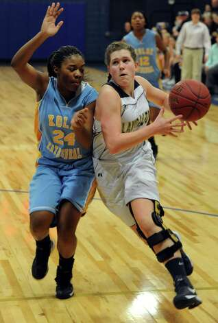 Lauralton Hall's Carly Fabbri drives the ball against Kolbe Cathedral's Kayle Weaver during SWC girls high school basketball semi-final action at Notre Dame High School, in Fairfield, Conn., Feb. 20th, 2013. Photo: Ned Gerard / Connecticut Post