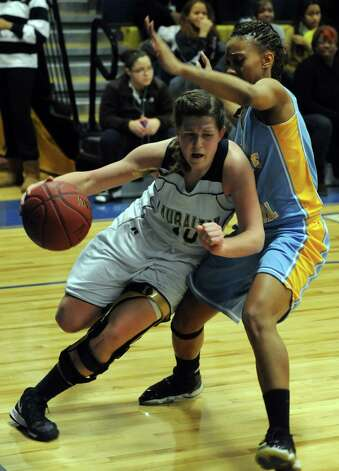 Lauralton Hall's Carly Fabbri drives past a Cathedral's defender during SWC girls high school basketball semi-final action at Notre Dame High School, in Fairfield, Conn., Feb. 20th, 2013. Photo: Ned Gerard / Connecticut Post