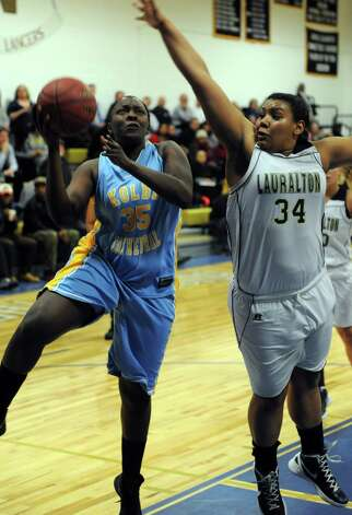 Koilbe Cathedral's Nakayla Nelson drives to the net past Lauralton Hall's Olive Levey during SWC girls high school basketball semi-final action at Notre Dame High School, in Fairfield, Conn., Feb. 20th, 2013. Photo: Ned Gerard / Connecticut Post