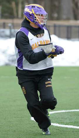 UAlbany lacrosse player Lyle Thompson runs with the ball during a practice on Wednesday Feb. 20, 2013 in Albany, N.Y. (Lori Van Buren / Times Union) Photo: Lori Van Buren