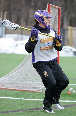 UAlbany lacrosse player Miles Thompson runs with the ball during a practice on Wednesday Feb. 20, 2013 in Albany, N.Y. (Lori Van Buren / Times Union) Photo: Lori Van Buren