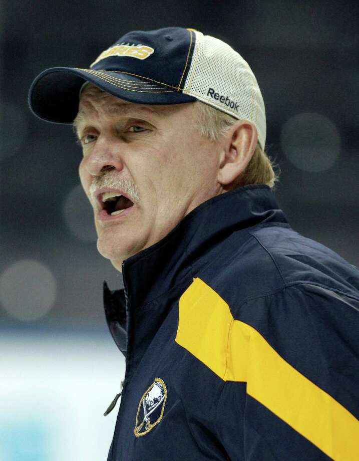 FILE - In this Jan. 11, 2012, file photo, Buffalo Sabres coach Lindy Ruff talks with players during NHL hockey practice in Buffalo, N.Y. Ruff was fired on Wednesday, Feb. 20, 2013, after the team's latest slow start to the season and amid growing criticism from the team's fan base. (AP Photo/David Duprey, File) Photo: David Duprey
