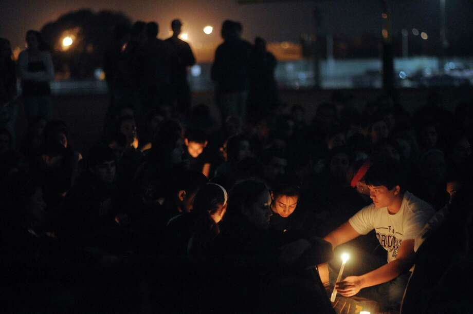 Brandeis High School students participate in a candlelight vigil on Wednesday, Feb. 20, 2013, for classmates involved in a fatal traffic accident near the intersection of Loop 1604 at Hausman Road on Tuesday. Photo: Billy Calzada, San Antonio Express-News / San Antonio Express-News