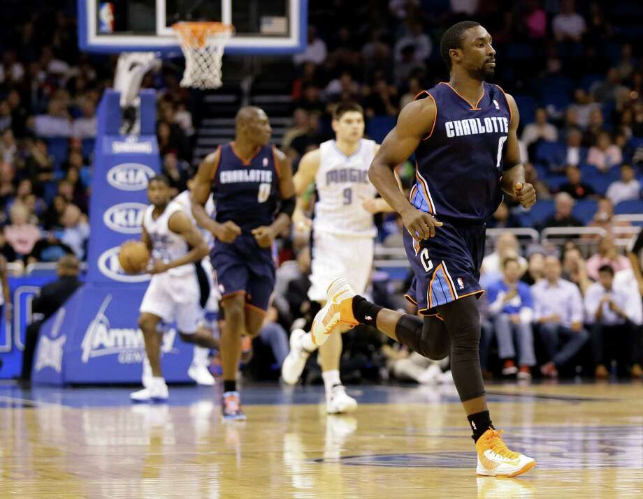Charlotte Bobcats' Ben Gordon (8) runs on the court during the first half of an NBA basketball game against the Orlando Magic in Orlando, Fla., Tuesday, Feb. 19, 2013. The Bobcats won 105-92.  (AP Photo/Willie J. Allen Jr.) Photo: Willie J. Allen Jr.