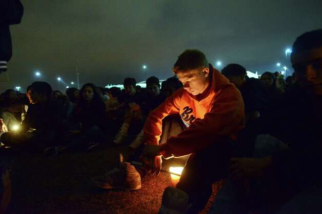 Nathan Jordan participates with fellow Brandeis High School students in a candlelight vigil for classmates involved in a fatal traffic accident near intersection of Loop 1604 at Hausman Road on Tuesday. Photo: Billy Calzada, San Antonio Express-News / San Antonio Express-News