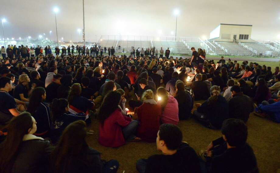 Several hundred Brandeis High School students participate on Wednesday, Feb. 20, 2013, in a candlelight vigil for classmates involved in a fatal traffic accident near the intersection of Loop 1604 at Hausman Road on Tuesday. Photo: Billy Calzada, San Antonio Express-News / San Antonio Express-News