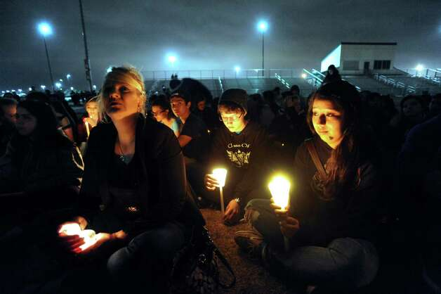 Brandeis High School students participate in a candlelight vigil on Wednesday night, Feb. 20, 2013, for classmates involved in a fatal traffic accident near the intersection of Loop 1604 at Hausman Road on Tuesday. Photo: Billy Calzada, San Antonio Express-News / San Antonio Express-News