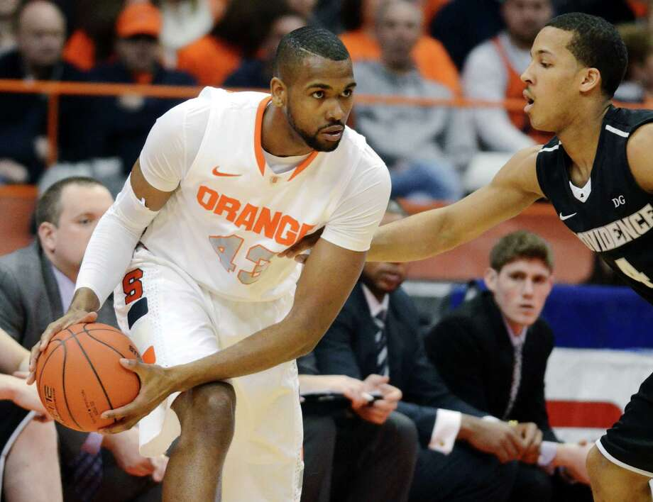 Syracuse's James Southerland, left, looks to pass against Providence's Josh Fortune during the first half in an NCAA college basketball game in Syracuse, N.Y., Wednesday, Feb. 20, 2013. (AP Photo/Kevin Rivoli) Photo: KEVIN RIVOLI