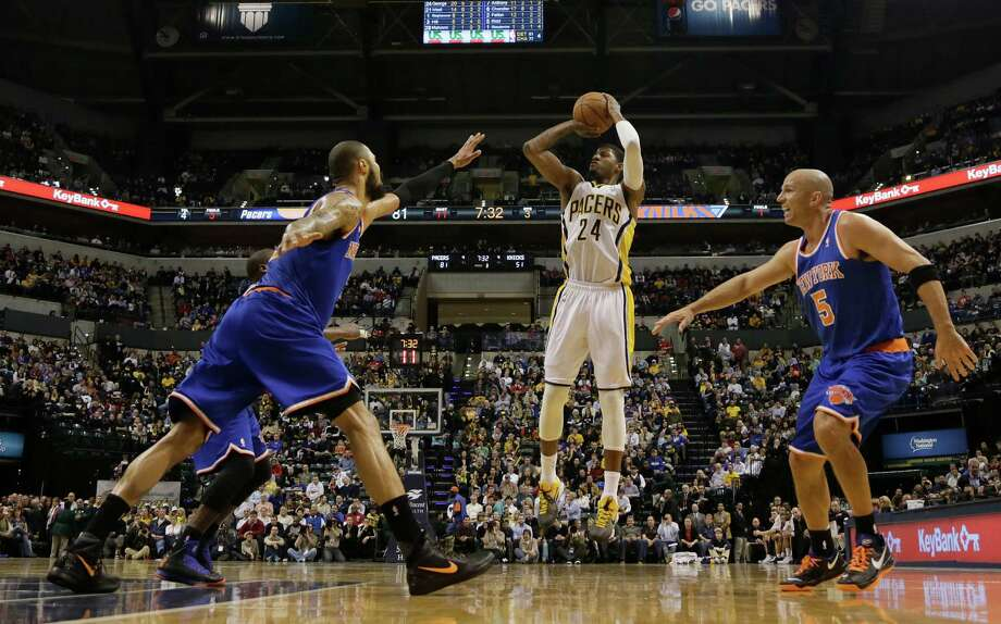 Indiana Pacers forward Paul George, center, shoots between New York Knicks defenders Tyson Chandler, left, and Jason Kidd during the second half of an NBA basketball game in Indianapolis, Wednesday, Feb. 20, 2013. The Pacers won 125-91. (AP Photo/AJ Mast) Photo: AJ MAST