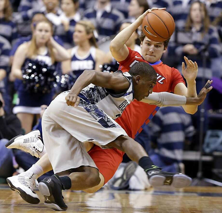 Georgetown forward Aaron Bowen, front, and DePaul forward Peter Ryckbosch scramble for a loose ball during the second half of an NCAA college basketball game, Wednesday, Feb. 20, 2013, in Washington. Georgetown won 90-66. (AP Photo/Alex Brandon) Photo: Alex Brandon, Associated Press