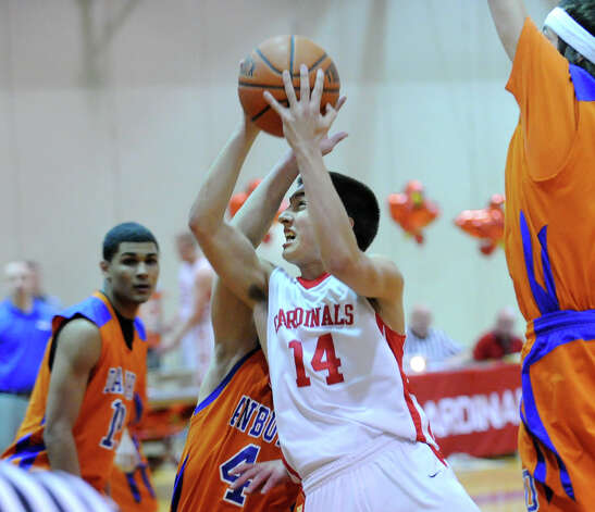 Thomas Baietto # 14 of Greenwich drives to the basket while being covered by Danbury's Corey Chaffee # 4 during the boys high school basketball game between Greenwich High School and Danbury High School at Greenwich, Wednesday, Feb. 20, 2013. Photo: Bob Luckey / Greenwich Time