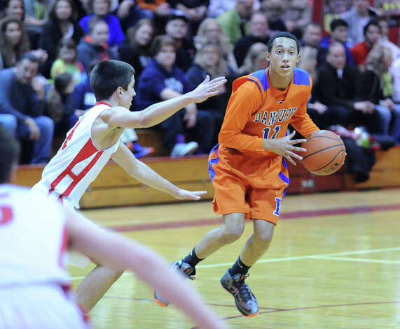 At right, Marquise Marrero # 11 of Danbury during the boys high school basketball game between Greenwich High School and Danbury High School at Greenwich, Wednesday, Feb. 20, 2013. Photo: Bob Luckey / Greenwich Time